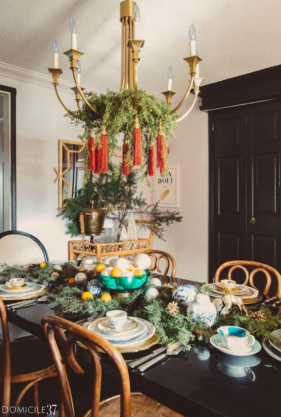 "<p>Your Christmas centerpiece should be a reflection of the rest of your home decor. If you want to give your dining table a <a href=""https://www.elledecor.com/design-decorate/room-ideas/g10241076/bohemian-room-decor/"" rel=""nofollow noopener"" target=""_blank"" data-ylk=""slk:bohemian"" class=""link rapid-noclick-resp"">bohemian</a> flair, experiment with texture. With leafy greens, tassels, and smooth ornaments, this tablescape option packs in the holiday cheer.</p><p><em><a href=""https://www.domicile37.com/orange-christmas-tablescape/"" rel=""nofollow noopener"" target=""_blank"" data-ylk=""slk:Via Domicile 37"" class=""link rapid-noclick-resp"">Via Domicile 37 </a></em></p>"