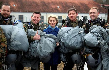 FILE PHOTO: German Defence Minister Ursula von der Leyen poses for a picture with paratroopers at the Franz-Josef Strauss Bundeswehr armybase in Altenstadt, Germany, February 3, 2017.     REUTERS/Michael Dalder/File Photo