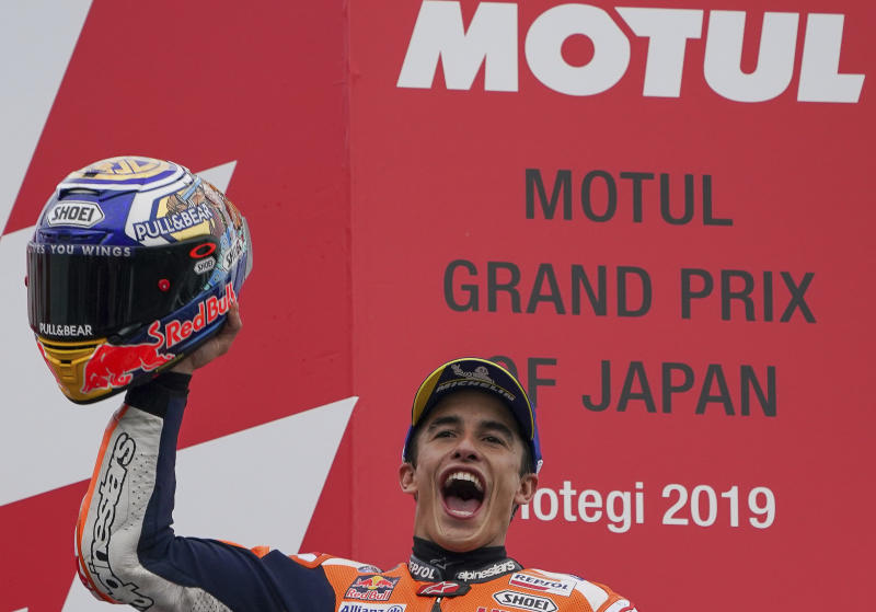Spain's MotoGP rider Marc Marquez celebrates after winning the MotoGP Japanese Motorcycle Grand Prix at the Twin Ring Motegi circuit in Motegi, north of Tokyo, Sunday, Oct. 20, 2019. (AP Photo/Christopher Jue)