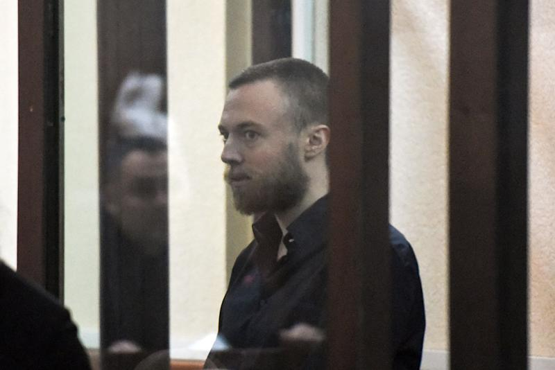 British citizen Jack Shepherd stands inside a defendants' cage during an extradiction hearing at a court in Tbilisi on March 26, 2019. - A Georgian court on March 26, 2019 ruled to extradite a British man who killed his date in a speedboat crash in London and gave himself up in the ex-Soviet republic after fleeing his country. (Photo by Vano Shlamov / AFP) (Photo credit should read VANO SHLAMOV/AFP/Getty Images)