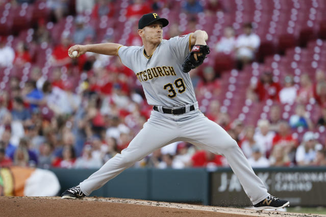 Pittsburgh Pirates starting pitcher Chad Kuhl throws during the first inning of a baseball game against the Cincinnati Reds, Wednesday, May 23, 2018, in Cincinnati. (AP Photo/John Minchillo)