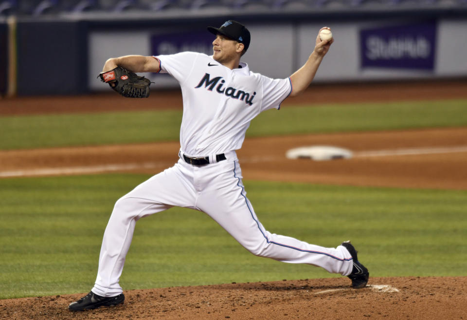 Miami Marlins' Ross Detwiler pitches against the Atlanta Braves during the sixth inning of a baseball game, Sunday, June 13, 2021, in Miami. (AP Photo/Jim Rassol)