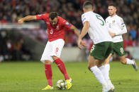 Switzerland's forward Haris Seferovic, left, scores the first goal against Republic of Ireland during their Euro 2020 qualifying Group D soccer match at the Stade de Geneve, in Geneva, Switzerland, Tuesday, Oct. 15, 2019. (Laurent Gillieron/Keystone via AP)