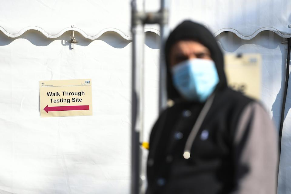 People queue up outside a coronavirus testing centre offering walk-in appointments in north London. (Photo by Kirsty O'Connor/PA Images via Getty Images)