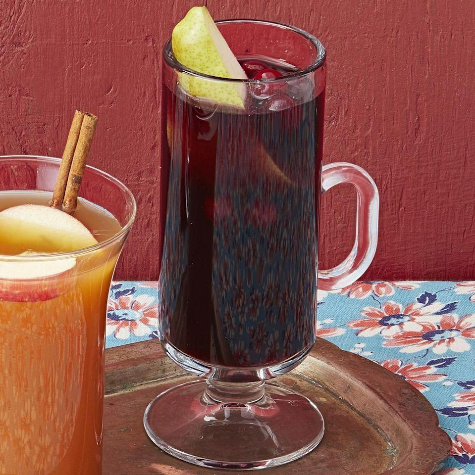 """<p>Opt for this classic fall drink for your Halloween party. This autumnal spice blend featuring cinnamon, clove, and ginger will be sure to warm your guests up.</p><p><strong><a href=""""https://www.thepioneerwoman.com/food-cooking/recipes/a33968509/cranberry-mulled-wine-recipe/"""" rel=""""nofollow noopener"""" target=""""_blank"""" data-ylk=""""slk:Get the recipe."""" class=""""link rapid-noclick-resp"""">Get the recipe.</a></strong></p><p><a class=""""link rapid-noclick-resp"""" href=""""https://go.redirectingat.com?id=74968X1596630&url=https%3A%2F%2Fwww.walmart.com%2Fip%2FLibbey-34-Oz-Super-Mug%2F134913956&sref=https%3A%2F%2Fwww.thepioneerwoman.com%2Fholidays-celebrations%2Fg36792938%2Fhalloween-punch-recipes%2F"""" rel=""""nofollow noopener"""" target=""""_blank"""" data-ylk=""""slk:SHOP GLASS MUGS"""">SHOP GLASS MUGS</a></p>"""