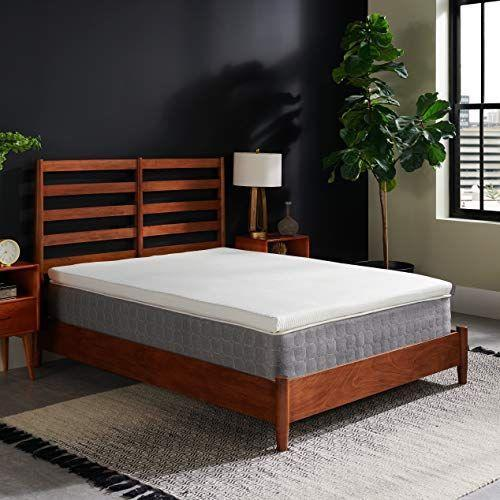 """<p><strong>Tempur-Pedic</strong></p><p>amazon.com</p><p><strong>$299.00</strong></p><p><a href=""""https://www.amazon.com/dp/B07V7R7V8F?tag=syn-yahoo-20&ascsubtag=%5Bartid%7C2140.g.36410876%5Bsrc%7Cyahoo-us"""" rel=""""nofollow noopener"""" target=""""_blank"""" data-ylk=""""slk:Shop Now"""" class=""""link rapid-noclick-resp"""">Shop Now</a></p><p>This topper has all the bells and whistles. It's made with three inches of Tempur material, so you're basically getting the feel of a new mattress at a fraction of the cost. It also has a cooling cover that's machine-washable.</p>"""