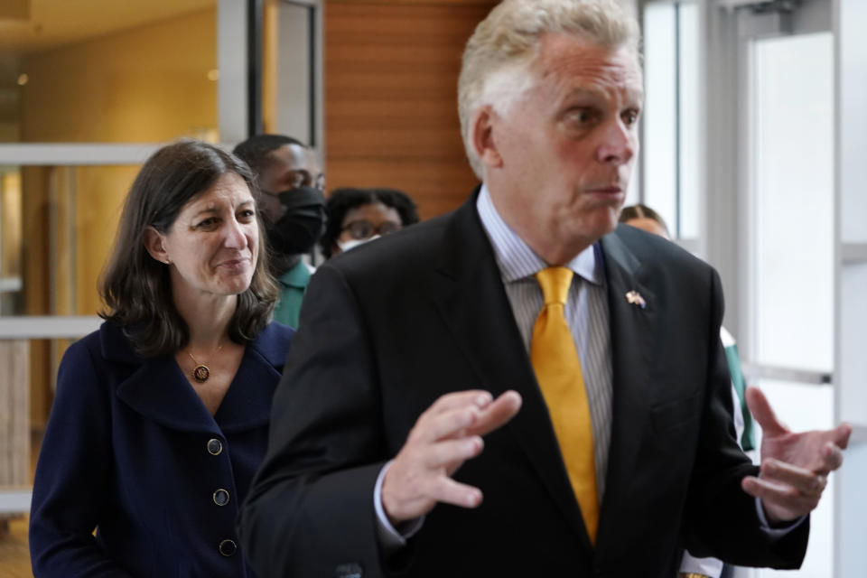 FILE - This July 15, 2021 file photo shows Democratic gubernatorial candidate former Governor, Terry McAuliffe, right, and US Rep. Elaine Luria, D-Va., during a tour of Norfolk State University Thursday July 15, 2021, in Norfolk, Va. McAuliffe issued a call Monday, Aug. 23, 2021 for all Virginia employers to require the COVID-19 vaccine for their workers, as a policy debate over how best to deal with the coronavirus pandemic dominates the closely watched race for governor. His opponent, former business executive and political newcomer Glenn Youngkin, who is vaccinated, has consistently urged voters to get the shot but has said he opposes vaccine mandates. (AP Photo/Steve Helber)