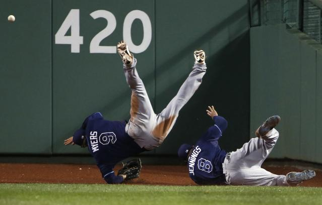Wil Myers, left, injured his wrist in this collision with teammate Desmond Jennings. (Getty Images)