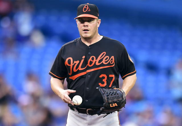 Baltimore Orioles starting pitcher Dylan Bundy (37) reacts after giving up a home run during fifth-inning baseball game action against the Toronto Blue Jays in Toronto, Friday, July 20, 2018. (Frank Gunn/The Canadian Press via AP)