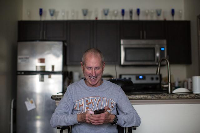 Yarling reacts to a text message from his friend Richard Blakely.