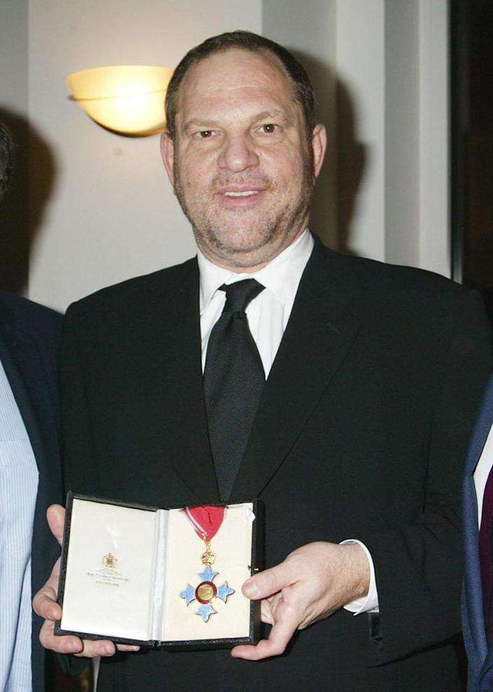 TIME OF DISTRIBUTION: IMMEDIATE NOVEMBER 24 PRNewswire, London, 24/11/2004: Harvey Weinstein received a CBE, Commander of the British Empire, at an investiture ceremony at the Residence of the British Consul General on Monday, November 22, 2004 in New York City. Photo includes (from left to right) Miramax co-chairmen Bob Weinstein and Harvey Weinstein and the British Consul General Sir Philip Thomas, Courtesy of DMIPhoto. Media contact: Matthew.hiltzik@miramax.com, tel +1-212-941-3883, Sarah.levinson@miramax.com, tel +1-212-941-3875. Visit www.mediapoint.press.net or www.prnewswire.co.uk. Media Contact: Matthew.hiltzik@miramax.com , tel +1-212-941-3883, Sarah.levinson@miramax.com, tel +1-212-941-3875 (PRNewsFoto) ... PRN_FILM_Miramax_Weinstein ... 24-11-2004 ... LONDON ... GBR ... Photo credit should read: Press Association Images. Unique Reference No. 2139769 ...