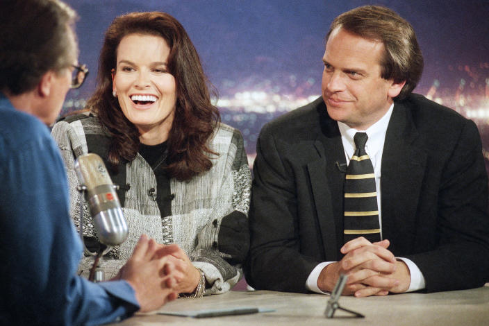 FILE - In this Feb. 10, 1997 file photo, Denise Brown, sister of murder victim Nicole Brown Simpson, center, and John Q. Kelly, Brown family attorney in the O.J. Simpson civil trial, right, speaks with talk-show host Larry King, left, in Los Angeles hours after jurors assessed Simpson $25 million in punitive damages for the deaths of Nicole Brown Simpson and Ronald Goldman. King, who interviewed presidents, movie stars and ordinary Joes during a half-century in broadcasting, has died at age 87. Ora Media, the studio and network he co-founded, tweeted that King died Saturday, Jan. 23, 2021 morning at Cedars-Sinai Medical Center in Los Angeles. (AP Photo/Rene Macura)