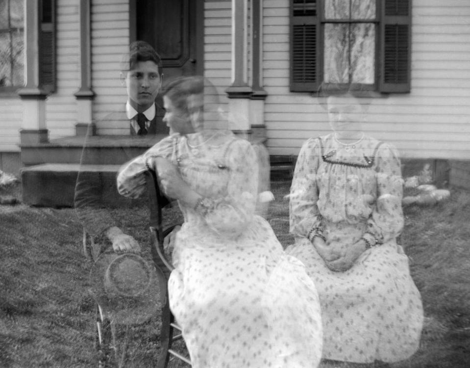 <p>Although it appears that there are three subjects in this photo, there are actually only two: one man and one woman. The double exposure effect was successfully utilized in order to duplicate the female subject. </p>