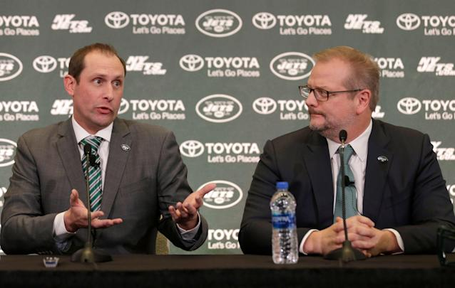 That didn't last long: Four months after hiring head coach Adam Gase, left, the New York Jets fired the man who had a role in his hiring, general manager Mike Maccagnan (right). (AP)