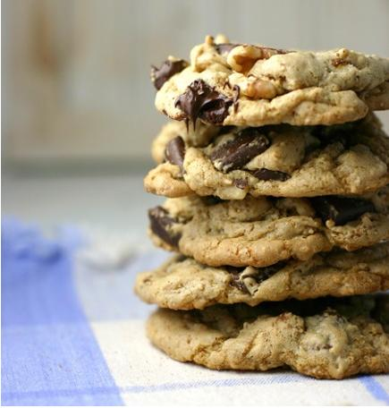 "<div class=""caption-credit""> Photo by: Brooke McLay</div><div class=""caption-title""></div><b>Skinny Chocolate Chip Cookies <br></b> These ""skinny"" chocolate chip cookies come in at just 65 calories per cookie, providing a tasty treat for those trying to keep their weight down. <br> <b>Ingredients</b> <br> 1/4 cup olive oil <br> 1/2 cup brown sugar <br> 1 egg <br> 1/4 teaspoon baking soda <br> 1 teaspoon vanilla <br> 1/2 cup Coach's Oats <br> 3/4 cup white whole wheat flour <br> 1/2 cup chopped walnuts <br> 1/2 cup dark or semisweet chocolate chunks <br> <b>Directions</b> <br> 1. In an electric mixer, beat together the olive oil, brown sugar, and egg until fluffy. Add the remaining ingredients and beat until well mixed. <br> 2. Use a medium (approximately 2 tablespoons in size) cookie scoop to place cookies on a cookie sheet. <br> 3. Bake in an oven preheated to 375 degrees for 8-10 minutes, or until golden brown around the edges. Makes 24 cookies."