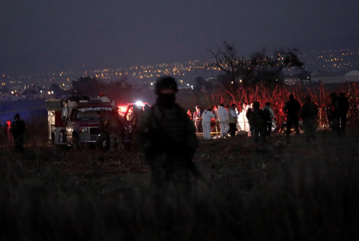 Emergency rescue personnel, the army and the police arrive to the scene of a helicopter crash where Puebla Gov. Martha Erika Alonso and her husband Rafael Moreno Valle, a former Puebla governor, died near Puebla City, southeast of Mexico City on Monday, Dec. 24, 2018. The husband-and-wife political power couple died Christmas Eve in the crash, Mexican officials reported. (AP Photo/Pablo Spencer)