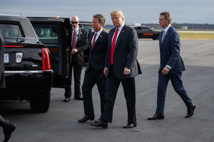 President Donald Trump arrives to speak at a campaign rally, Sunday, Nov. 4, 2018, in Macon, Ga. (AP Photo/Evan Vucci)