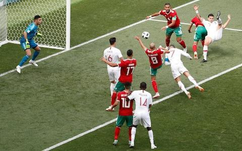 They do call Portugal a one-man team and when that one man is Cristiano Ronaldo, a footballer so famous that even the Russians would not need to see his passport, you can understand why the World Cup finals has fallen under his spell. Without Ronaldo, there would be none of the four goals registered by Portugal in this tournament including the winner against Morocco, which has taken his overall tally to 85, the most scored in international football by a European footballer. Without Ronaldo this would be a mediocre team, rather than a mediocre team with a first-class goalscorer who barely has to flash a glance at the camera to get himself voted the sponsors' man of the match. Yet Portugal are a bit more than that. They also encompass Pepe, Ronaldo's erstwhile Real Madrid team-mate, who slumped to the ground in agony when Menat Benatia tapped him on the shoulder, and also launched himself like a bowling ball at the Morocco defenders who were trying to block the corner from which Portugal scored. Portugal, are also the goalkeeper Rui Patricio, on his way to Wolverhampton Wanderers, whose fine save in the second half from Younes Belhandia preserved his team's lead. But mostly Portugal are a team happy to defend whatever margin Ronaldo's opportunism affords them, a side that will only relinquish a lead if their fingers are prised off one by one. Even their usually unrepentant coach Fernando Santos admitted this was an unambitious performance and affected dismay that his players should back off Morocco for most of the 86 minutes after Ronaldo's goal - although that seems to be the usual gameplan. From Morocco, the first team eliminated from Russia 2018, there was everything but a goal. Their white-shirted, lantern-jawed French coach Herve Renard, who watches from the touchline like a Monaco divorcee scrutinising the dance-floor, listed all the things he was proud of afterwards and lamented the performance of the American referee. Mark Geiger, he intimated, had failed to s