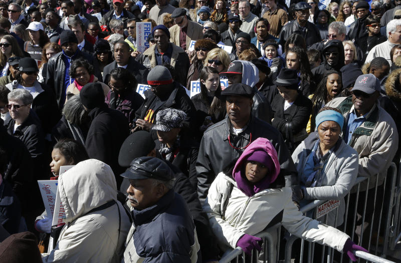 Thousands of residents await the arrival of Vice President Joe Biden for the annual Bridge Crossing Ceremony in Selma, Ala., Sunday, March 3, 2013. Biden is traveling to Selma on Sunday to participate in the Bridge Crossing Jubilee. The event commemorates the 1965 march, which prompted Congress to pass the Voting Rights Act and add millions of African-Americans to Southern voter rolls. (AP Photo/Dave Martin)
