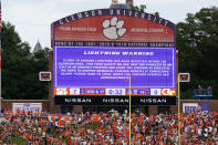 A sign warns fans about lightning in the area in the first half of an NCAA college football game between Clemson and Georgia Tech, Saturday, Sept. 18, 2021, in Clemson, S.C. The field was cleared and both teams were sent to their locker rooms. (AP Photo/John Bazemore)