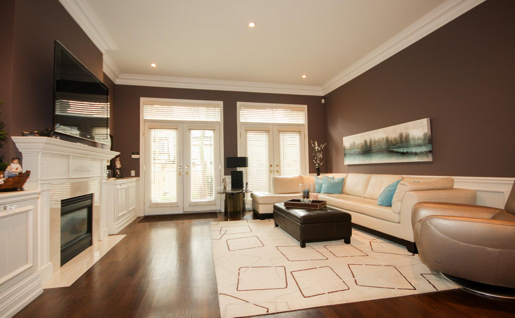 <p>The living room has a gas fireplace. (Royal LePage/BizzImage) </p>