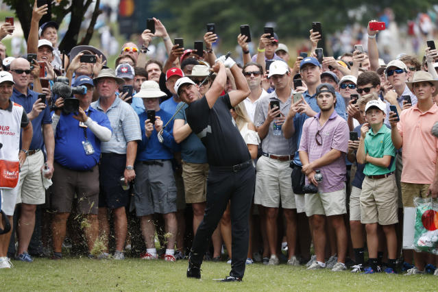 Brooks Koepka hits from off the first fairway during the final round of the Tour Championship golf tournament Sunday, Aug. 25, 2019, at East Lake Golf Club in Atlanta. (AP Photo/John Bazemore)
