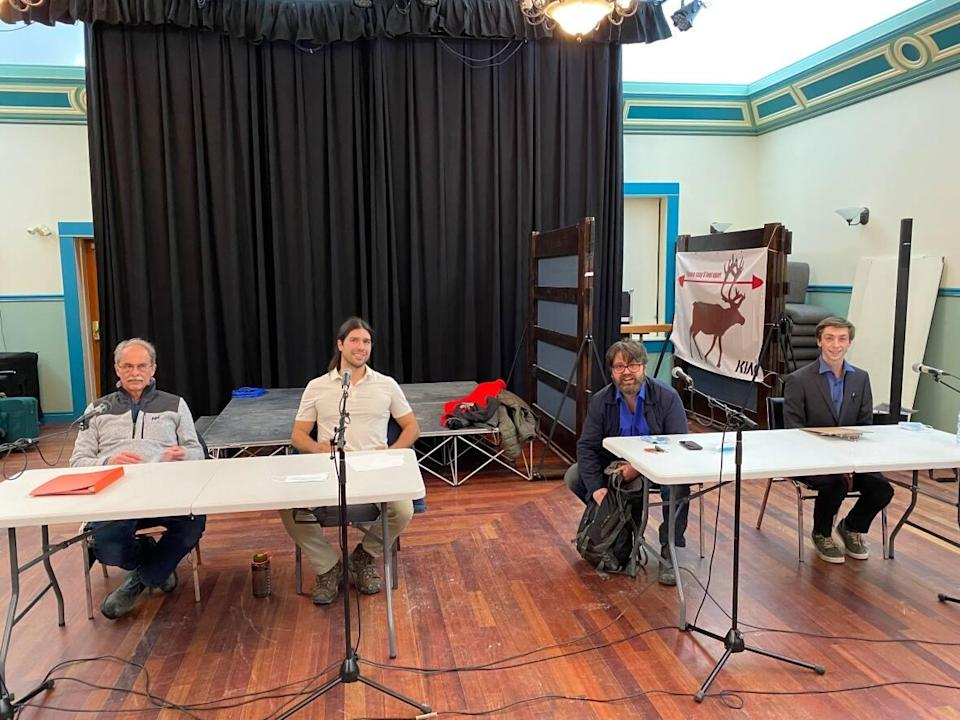 The four candidates running for mayor of Dawson City at a municipal election forum. They are, from left to right, Stephen Johnson, Kevin Mendelsohn, Bill Kendrick and Xen Van Nostrand. (Chris MacIntyre/CBC - image credit)