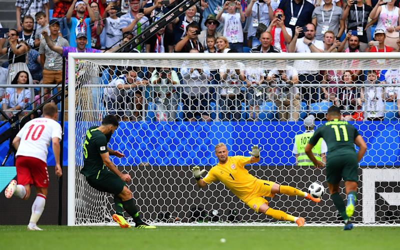 Mile Jedinak scores from the penalty spot for Australia - REUTERS