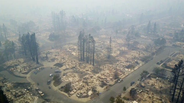<p>This aerial image shows a neighborhood that was destroyed by a wildfire in Santa Rosa, Calif., Tuesday, Oct. 10, 2017. (Photo: Nick Giblin/DroneBase via AP) </p>