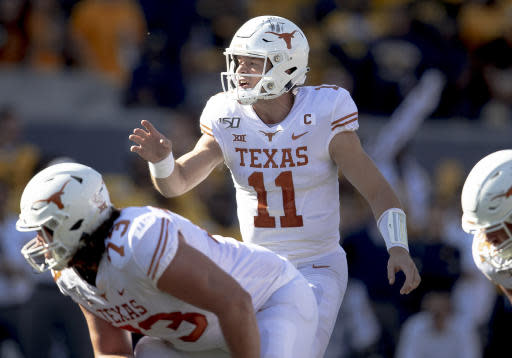 Texas quarterback Sam Ehlinger (11) shouts to his lineman during an NCAA football game against West Virginia, Saturday, Oct. 5, 2019, in Morgantown, W.Va. (Nick Wagner/Austin American-Statesman via AP)