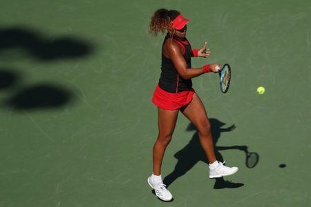 Mar 21, 2018; Key Biscayne, FL, USA; Naomi Osaka of Japan hits a forehand against Serena Williams of the United States (not pictured) on day two of the Miami Open at Tennis Center at Crandon Park. Osaka won 6-3, 6-2. Mandatory Credit: Geoff Burke-USA TODAY Sports