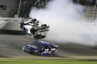 Chris Buescher (17) goes low to avoid Ryan Newman (6) a he wrecks and flips on the final lap of the NASCAR Daytona 500 auto race at Daytona International Speedway, Monday, Feb. 17, 2020, in Daytona Beach, Fla. Sunday's race was postponed because of rain. (AP Photo/Terry Renna)