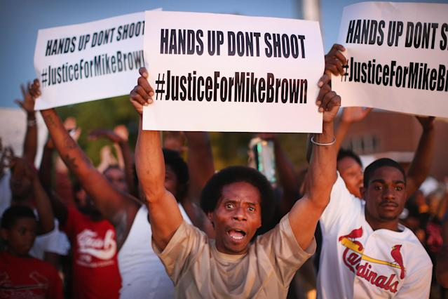 <p>Demonstrators protest the killing of teenager Michael Brown outside Greater St. Marks Family Church while Browns family along with civil rights leader Rev. Al Sharpton and a capacity crowd of guests met inside to discuss the killing on August 12, 2014 in St Louis, Missouri. Brown was shot and killed by a police officer on Saturday in the nearby suburb of Ferguson. Ferguson has experienced two days of violent protests since the killing but, tonight the town remained mostly peaceful. (Scott Olson/Getty Images) </p>