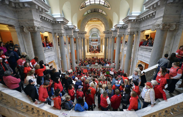 <p>Teachers from across Kentucky fill the state Capitol to rally for increased funding and to protest changes to their state funded pension system, Monday, April 2, 2018, in Frankfort, Ky. (Photo: Timothy D. Easley/AP) </p>