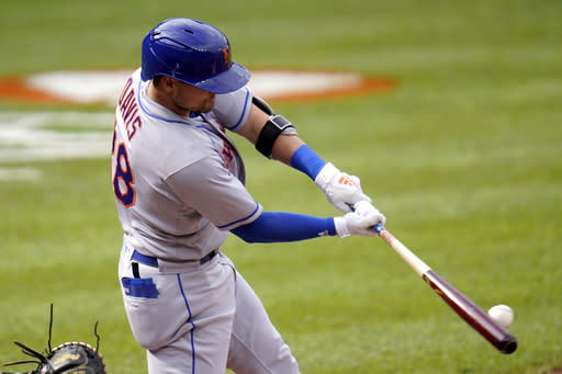 New York Mets designated hitter J.D. Davis connects for a single against Baltimore Orioles starting pitcher John Means during the first inning of a baseball game, Wednesday, Sept. 2, 2020, in Baltimore. (AP Photo/Julio Cortez)