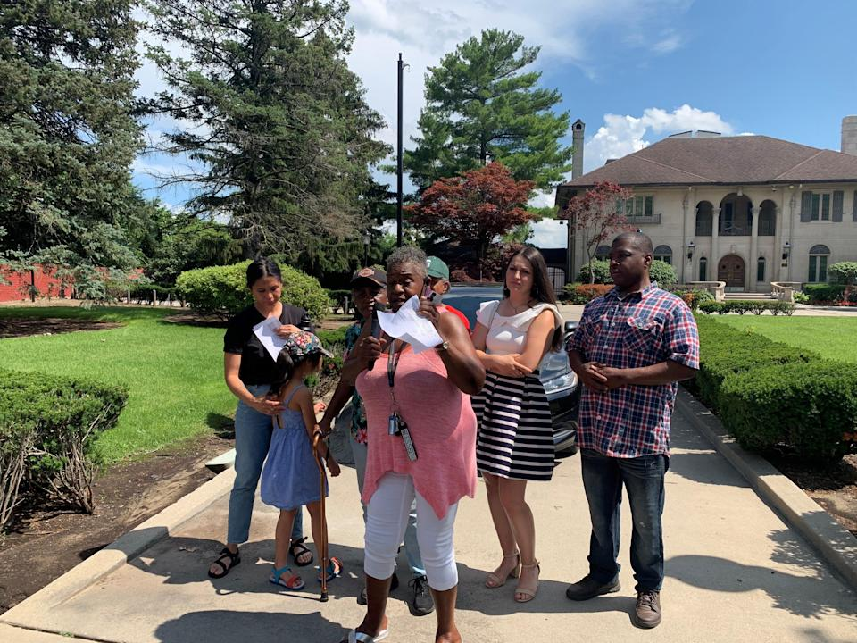 Daisy Jackson, with the Field Street Block Club, stands with residents of her community at a protest in front of Detroit Mayor Mike Duggan's mansion.