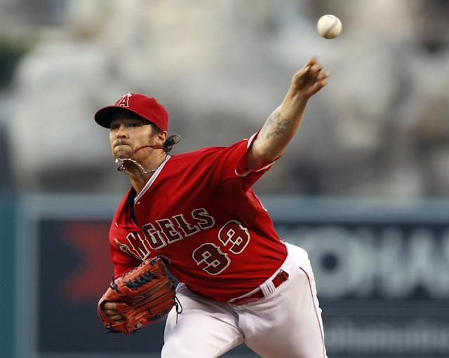 Los Angeles Angels starting pitcher C.J. Wilson throws against the Los Angeles Dodgers in the first inning of a baseball game Thursday, Aug. 7, 2014, in Anaheim, Calif. (AP Photo/Alex Gallardo)