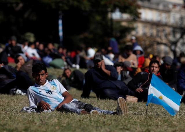An Argentina fan watches a broadcast of the World Cup Group D Nigeria v Iceland soccer match, at a public viewing area at a square in Buenos Aires, Argentina, June 22, 2018. REUTERS/Martin Acosta