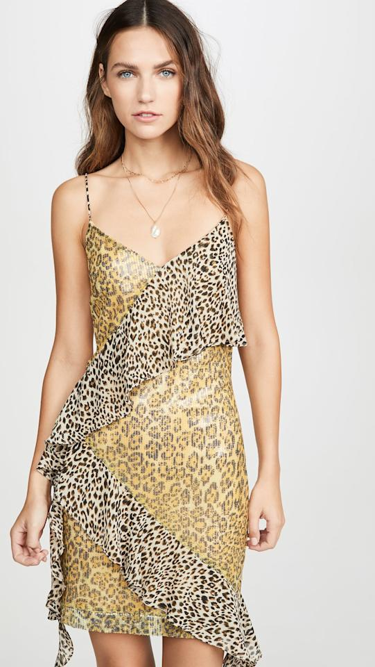 """<p>We love the mixed prints on this <a href=""""https://www.popsugar.com/buy/Endless-Rose-Spangle-Leopard-Pattern-Dress-494943?p_name=Endless%20Rose%20Spangle%20Leopard%20Pattern%20Dress&retailer=shopbop.com&pid=494943&price=90&evar1=fab%3Aus&evar9=45675751&evar98=https%3A%2F%2Fwww.popsugar.com%2Ffashion%2Fphoto-gallery%2F45675751%2Fimage%2F46684586%2FEndless-Rose-Spangle-Leopard-Pattern-Dress&list1=shopping%2Cfall%20fashion%2Cdresses%2Cwinter%20fashion&prop13=mobile&pdata=1"""" rel=""""nofollow"""" data-shoppable-link=""""1"""" target=""""_blank"""" class=""""ga-track"""" data-ga-category=""""Related"""" data-ga-label=""""https://www.shopbop.com/spangle-leopard-pattern-dress-endless/vp/v=1/1509238244.htm?folderID=13351&amp;fm=other-shopbysize-viewall&amp;os=false&amp;colorId=1040F"""" data-ga-action=""""In-Line Links"""">Endless Rose Spangle Leopard Pattern Dress</a> ($90).</p>"""