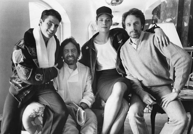 Tom Cruise, Don Simpson, Kelly McGillis and Jerry Bruckheimer on the set of the original <em>Top Gun</em>. (Photo: ©Paramount/Courtesy Everett Collection)