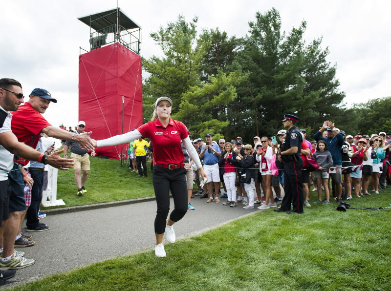Canada's Brooke Henderson greets fans on the 16th hole during the second round of the CP Women's Open golf tournament in Aurora, Ontario, Friday, Aug. 23, 2019. (Nathan Denette/The Canadian Press via AP)