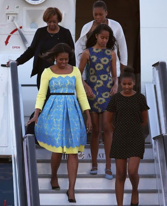 "<p>Across the pond to promote Let Girls Learn, Michelle Obama made her grand entrance to the United Kingdom wearing a yellow and robin's egg blue fit and flare dress. Designed by Preen by Thornton Bregazzi, this dress was modified from a similar version from the <a href=""http://www.avenue32.com/blue-lace-lou-dress-51101/?utm_source=polyvore&utm_medium=affiliate&utm_campaign=day+dresses¤cy=2&utm_source=LinkShare&utm_medium=Affiliate&utm_campaign=USNetwork&utm_term=QFGLnEolOWg&utm_content=15&mid=37532&siteID=QFGLnEolOWg-fa838jXUyhajz4SSDyMqUQ"" rel=""nofollow noopener"" target=""_blank"" data-ylk=""slk:Resort 2015 collection"" class=""link rapid-noclick-resp"">Resort 2015 collection</a>. </p>"