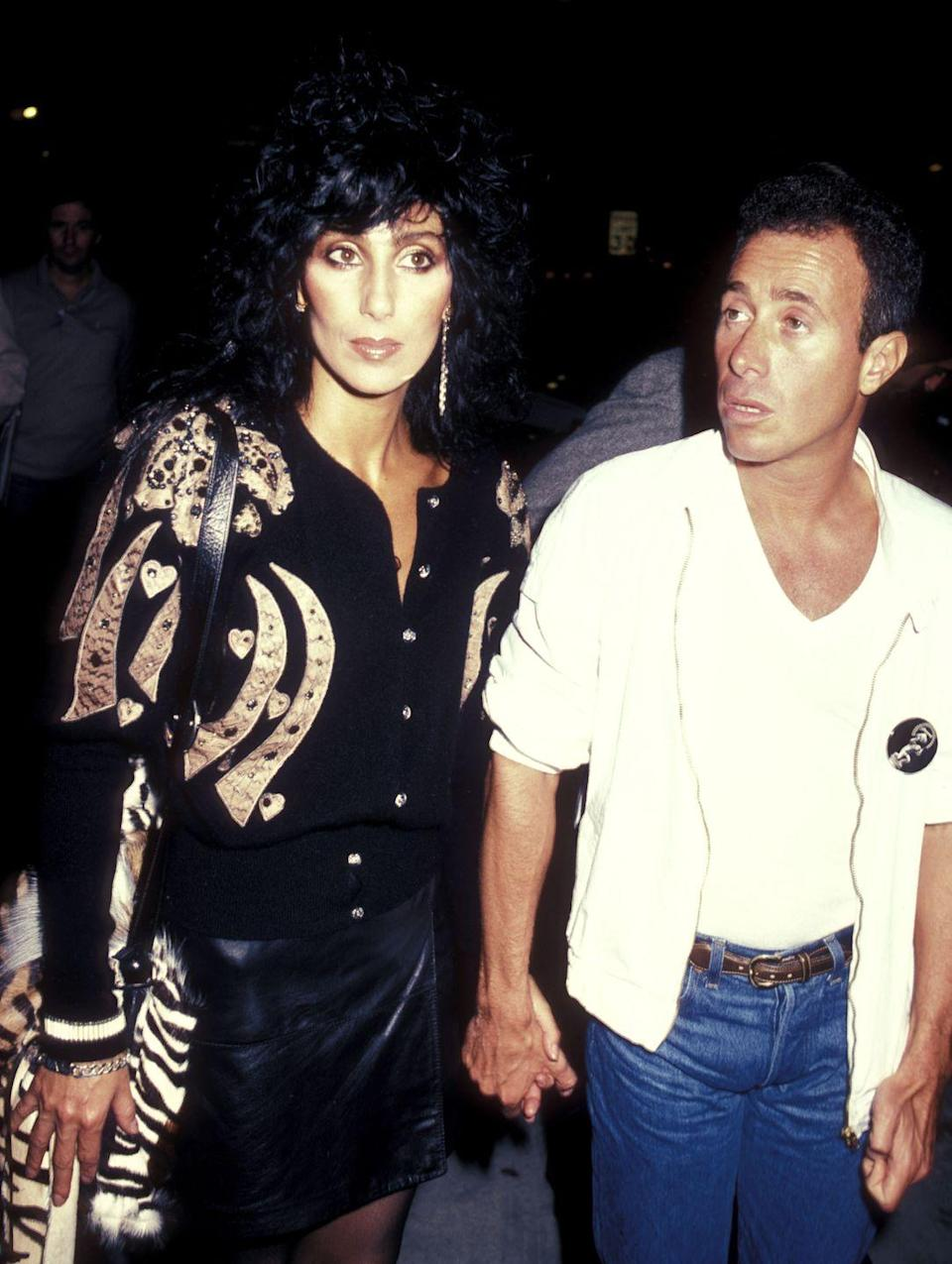 <p>Cher mixed '80s glam with her own signature touches when she attended an August party at the Hard Rock Cafe alongside producer David Geffen.<br></p>