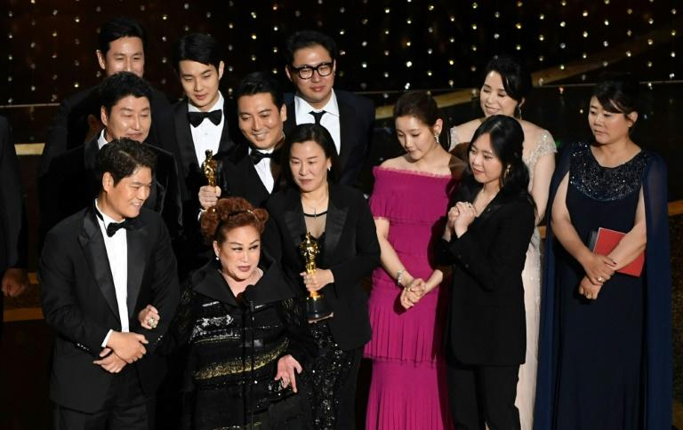 The unprecedented Oscars haul for 'Parasite' is the culmination of a corporate push into Hollywood that Miky Lee (2nd L front) has spearheaded for years