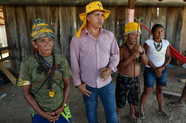 Brazilian illegal gold miner Inacio Vilela (2-L) and Munduruku indigenous people, speak with AFP in Morais Almeida, Itaituba, Para state, Brazil, on September 13, 2019. Members of an indigenous tribe have called for wildcat miners to be allowed to prospect for gold on their land
