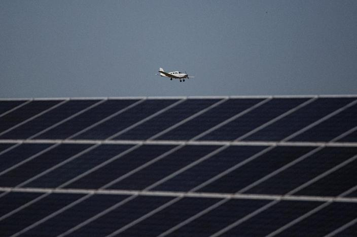 George airport's 2,000 solar panels produce up to 750 kW every day, easily surpassing the 400 kW needed to run the facility (AFP Photo/Gianluigi Guercia)