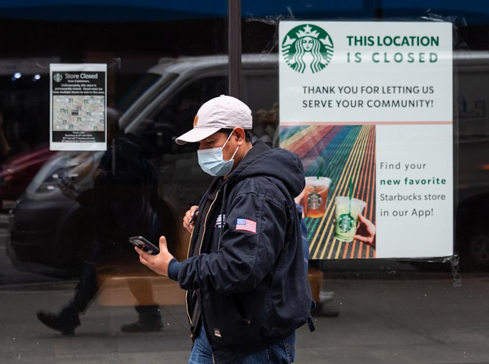 NEW YORK, NEW YORK - OCTOBER 28: A person walks by a permanently closed Starbucks location as the city continues the re-opening efforts following restrictions imposed to slow the spread of coronavirus on October 28, 2020 in New York City. The pandemic continues to burden restaurants and bars as businesses struggle to thrive with evolving government restrictions and social distancing plans which impact keeping businesses open yet challenge profitability. (Photo by Noam Galai/Getty Images)