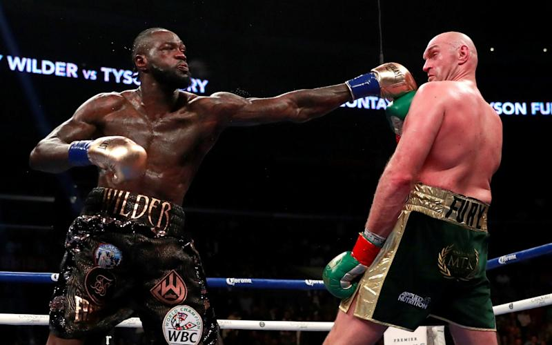 Deontay Wilder in action against Tyson Fury - Reuters