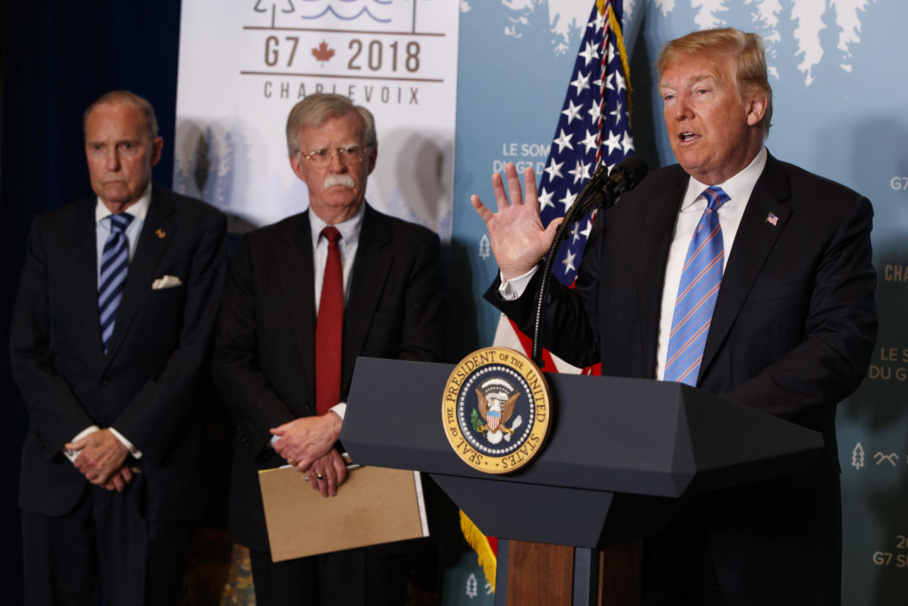 <p>White House chief economic adviser Larry Kudlow, left, and National Security Adviser John Bolton look on as President Donald Trump speaks during a news conference at the G-7 summit, Saturday, June 9, 2018, in La Malbaie, Quebec, Canada. (Photo: Evan Vucci/AP) </p>
