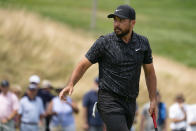 Jason Day acknowledges the crowd after sinking a birdie on the first green during the third round of the Travelers Championship golf tournament at TPC River Highlands, Saturday, June 26, 2021, in Cromwell, Conn. (AP Photo/John Minchillo)